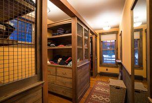Craftsman Closet with Lamont Home Kianna Hamper, Hardwood floors, flush light, Built-in bookshelf