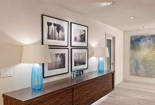 Contemporary Hallway with Built-in bookshelf, Hardwood floors, French doors