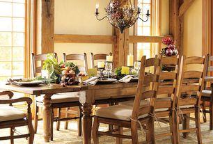 Rustic Dining Room with Standard height, picture window, Columns, Hardwood floors, Chandelier
