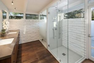 Contemporary Master Bathroom with Hardwood floors, frameless showerdoor, Undermount sink, Soapstone counters, flush light