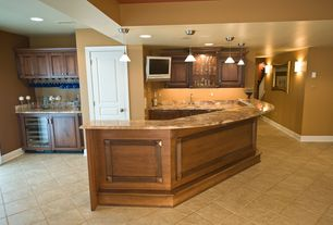 Traditional Bar with Standard height, Built-in bookshelf, specialty door, Pendant light, can lights, Concrete tile , Paint 1