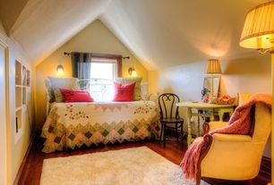 Country Kids Bedroom with Hardwood floors, Wall sconce, Built-in bookshelf