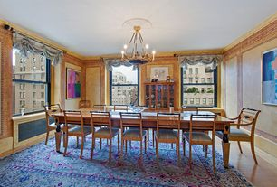Traditional Dining Room with Chandelier, Hardwood floors, Built-in bookshelf