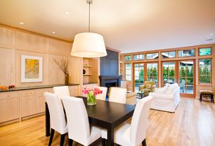Contemporary Great Room with Standard height, Pendant light, can lights, Crown molding, picture window, French doors