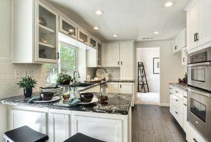 Contemporary Kitchen with Kaska porcelain tile - aztec series, Subway Tile, Complex granite counters, Raised panel, Flush