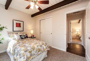 Cottage Guest Bedroom with Ceiling fan, Built-in bookshelf, Standard height, Carpet, Paint 1, Exposed beam, specialty door