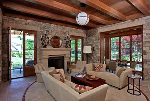 Rustic Living Room with French doors, Exposed beam, slate floors, Cement fireplace, Pendant light