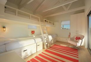 Contemporary Kids Bedroom with Hardwood floors, Window seat, Built-in bookshelf, Bunk beds, Exposed beam, High ceiling