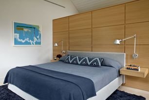 Contemporary Master Bedroom with Laminate floors, Safavieh milan shag navy rug (7' square), High ceiling