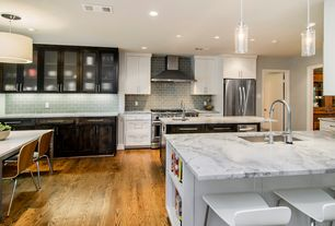 Contemporary Kitchen with Pendant light, Undermount sink, Breakfast nook, Kitchen island, Hardwood flooring, Subway Tile