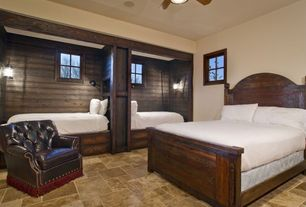 Country Guest Bedroom with travertine tile floors, Built-in bookshelf, Ceiling fan, Built in bed, Wall sconce