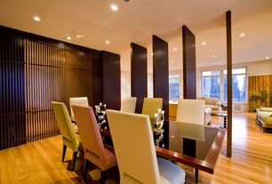 Contemporary Dining Room with Laminate floors, specialty door