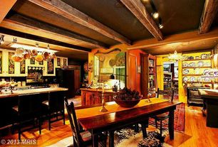 Country Dining Room with flush light, Hardwood floors, Exposed beam