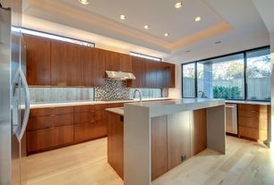 Contemporary Kitchen with Corian counters, European Cabinets, U-shaped, Dupont Corian Designer White, Ceramic Tile, Flush