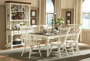 Traditional Dining Room with Laminate floors, Wainscotting, Standard height, Arched window