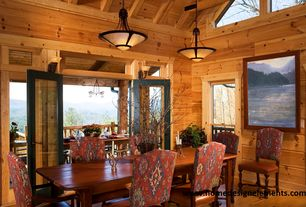 Rustic Dining Room with Lexington fieldale lodge aspen side chair, Wall sconce, Transom window, French doors, Exposed beam