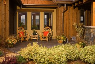 Country Patio with exterior stone floors, specialty window, Pathway