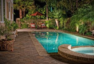 Tropical Swimming Pool with Pool with hot tub, Casement, exterior stone floors, Fence, Pathway