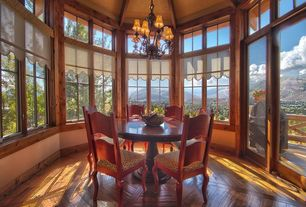Craftsman Dining Room with can lights, Balcony, Hardwood floors, Chandelier, Casement, High ceiling, picture window