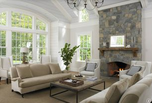 Cottage Living Room with Hardwood floors, Arched window, stone fireplace, Crown molding, Carlisle slipcovered sofa