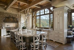 Traditional Kitchen with Exposed beam, Breakfast bar, Farmhouse sink, Raised panel, Complex granite counters, Custom hood