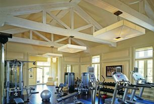 Traditional Home Gym with Chandelier, French doors, ProForm Comfort Stride Rear Drive Elliptical, flush light, Transom window