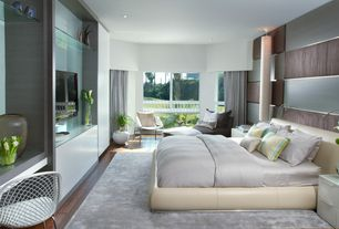 Contemporary Master Bedroom with Paint 1, can lights, Rossetto pavo bed, Laminate floors, Built-in bookshelf, Pendant light