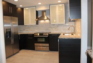 Contemporary Kitchen with Wall Hood, Subway Tile, Built In Refrigerator, Standard height, U-shaped, Paint 1, Flush, gas range