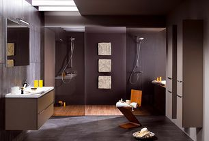 Contemporary Master Bathroom with Skylight, Corian counters, European Cabinets, Handheld showerhead, Zigzag chair