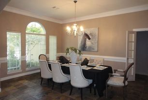 Traditional Dining Room with Arched window, Chair rail, Chandelier, French doors, travertine tile floors, Crown molding