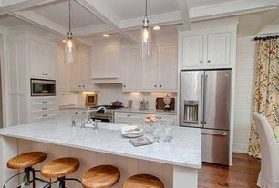 Traditional Kitchen with can lights, Standard height, L-shaped, Hardwood floors, Multiple Refrigerators, Kitchen island