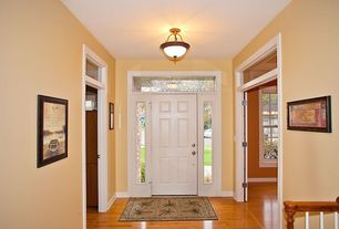 Traditional Entryway with flush light, Laminate floors, Transom window