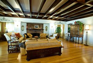 Traditional Living Room with Standard height, brick fireplace, Paint 2, Fireplace, Wall sconce, can lights, Exposed beam