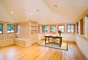 Contemporary Home Office with interior wallpaper, High ceiling, Window seat, Hardwood floors, Built-in bookshelf