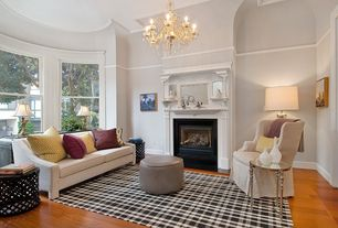 Traditional Living Room with Crown molding, Chandelier, Cement fireplace, Hardwood floors