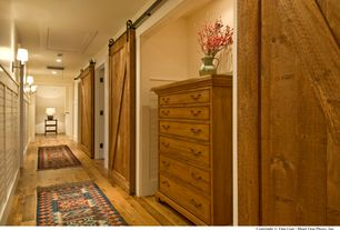 Country Hallway with Agave Ironworks RH201 Basic Wheel & Carrier - Smooth, Wall sconce, Hardwood floors, specialty door