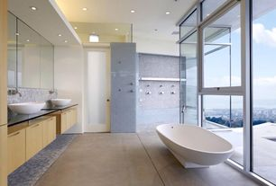 Contemporary Master Bathroom with Freestanding, Concrete tile , Flush, European Cabinets, Vessel sink, Glass counters, Quartz