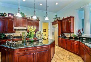 Craftsman Kitchen with Crown molding, sandstone tile floors, Kitchen island, Built-in bookshelf, Columns, Granite countertop
