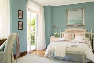 Traditional Master Bedroom with Wall sconce, French doors, Hardwood floors, Crown molding