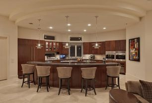 Contemporary Kitchen with U-shaped, limestone tile floors, Undermount sink, Pendant light, Glass panel, Kitchen island, Flush