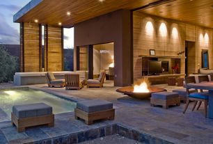 Contemporary Patio with exterior stone floors, Fence, Fire pit