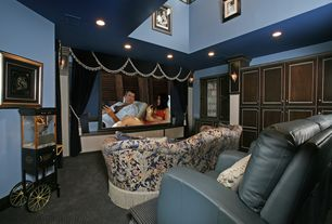 Traditional Home Theater with Carpet, Casement, Cathedral ceiling, Built-in bookshelf, can lights