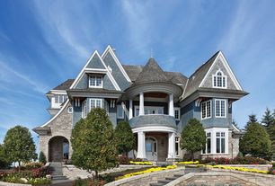 Traditional Exterior of Home with Raised beds, Pathway, specialty window, picture window, Deck Railing, Glass panel door