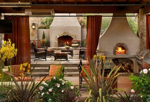 Mediterranean Patio with Raised beds, exterior concrete tile floors, Outdoor kitchen, exterior tile floors