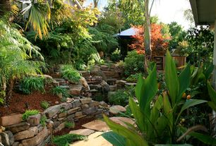 Tropical Landscape/Yard with Pathway, Eagle Mountain Ledgestone, Pond, exterior stone floors, Arizona Buff Flagstone