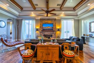 Eclectic Living Room with Fireplace, Casement, Ceiling fan, Crown molding, can lights, Hardwood floors, stone fireplace