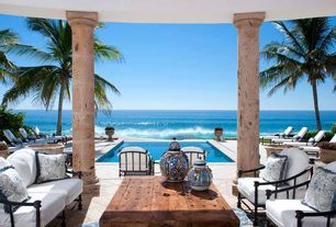 Tropical Porch with exterior stone floors, Sorrento lounge chair with cushions, Keko coffee table, Cabo san lucas, mexico