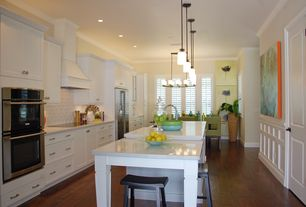 """Contemporary Kitchen with Custom hood, specialty door, White quartz countertop in """"snowstorm"""", Hammersmith subway tile, Flush"""
