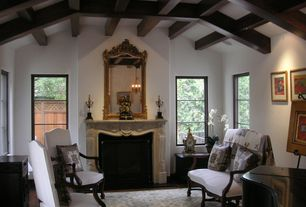 Traditional Living Room with Hardwood floors, Cement fireplace, Chandelier, Exposed beam, High ceiling