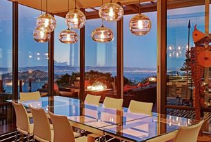 Contemporary Dining Room with Standard height, sliding glass door, Hardwood floors, Pendant light, picture window